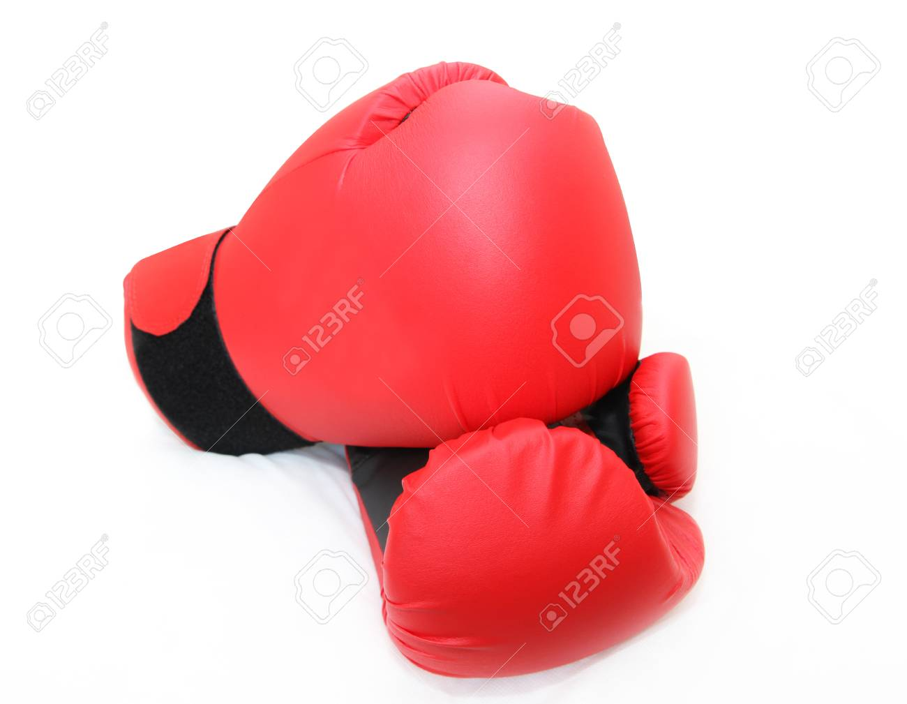 red boxing gloves isolated  isolated in white Stock Photo - 23550786