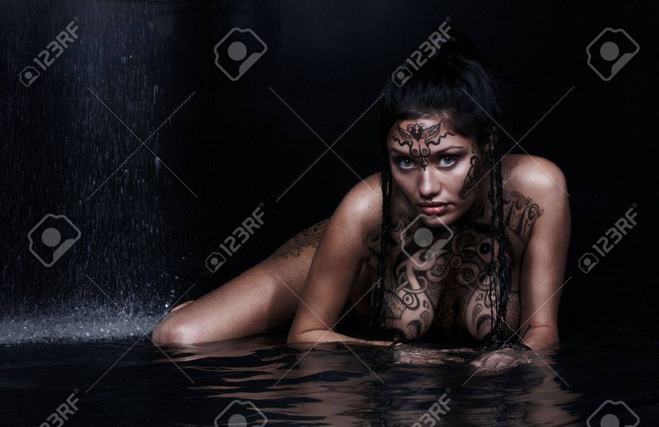 Beautiful model with bodypainting in water on black Stock Photo - 4755760