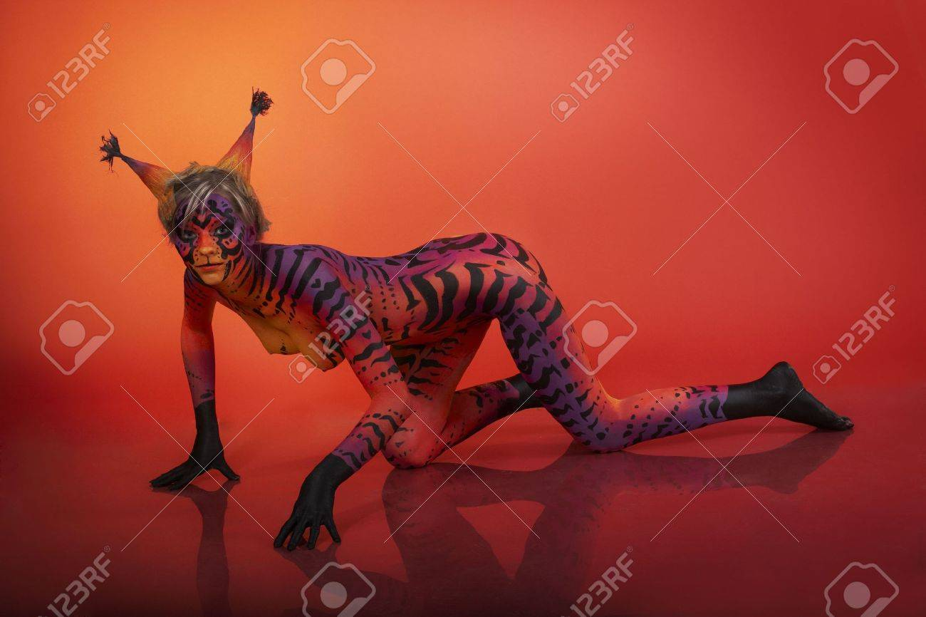 Beautiful model with body art - cat on red background Stock Photo - 4858607