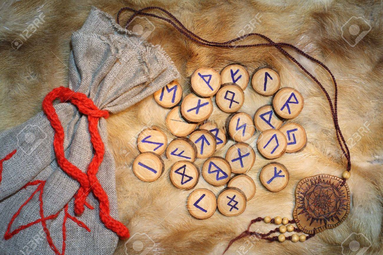 Handmade rune set with pouch, these runes were made by the photographer Stock Photo - 2139519