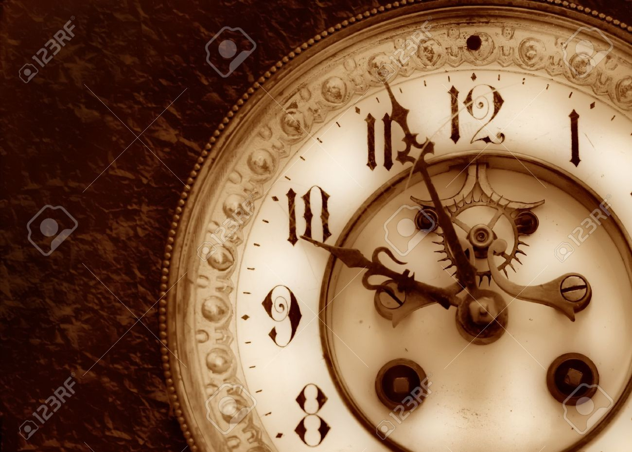 Old clock on the relief background Stock Photo - 4175943
