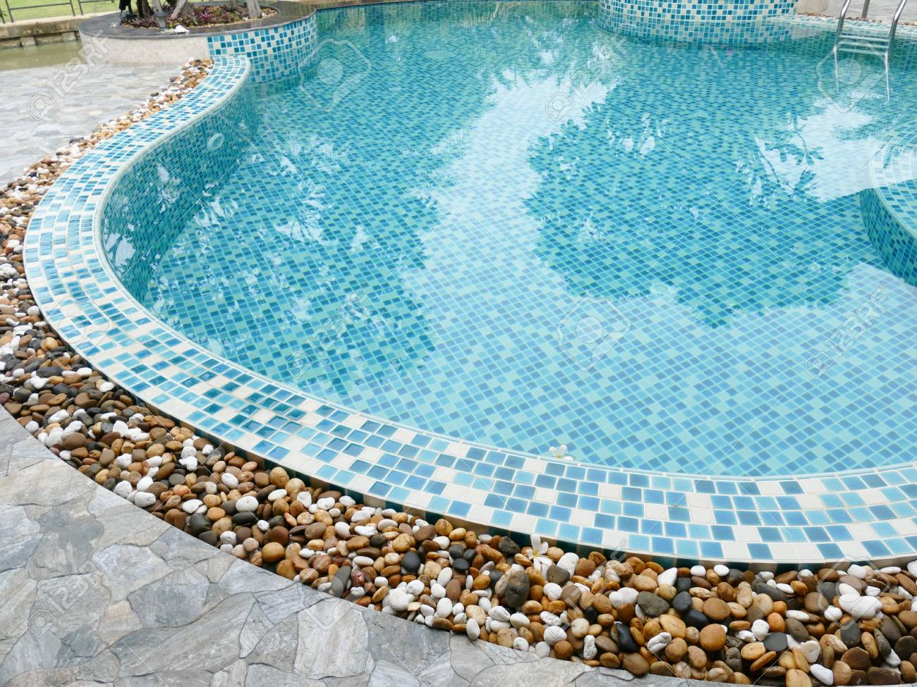 Small Stone Decorating On The Edge Of The Swimming Pool Stock Photo Picture And Royalty Free Image Image 43099036