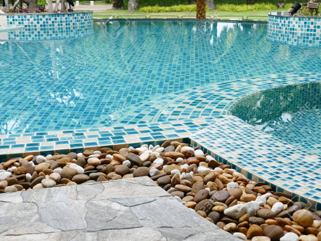 Small Stone Decorating On The Edge Of The Swimming Pool Stock Photo Picture And Royalty Free Image Image 43098992