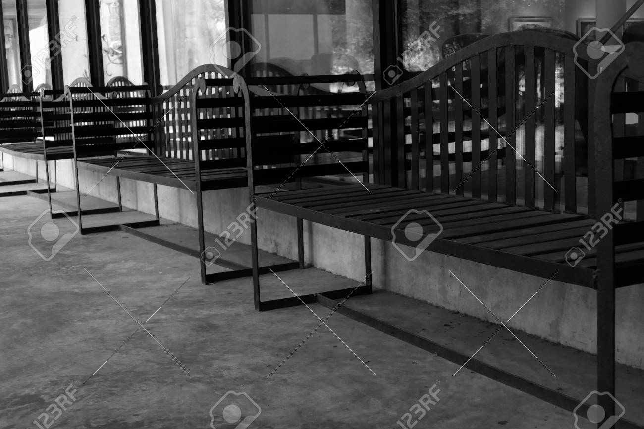 Picture of: Row Of Black Metal Bench On The Patio Of The Building Black Stock Photo Picture And Royalty Free Image Image 49728153