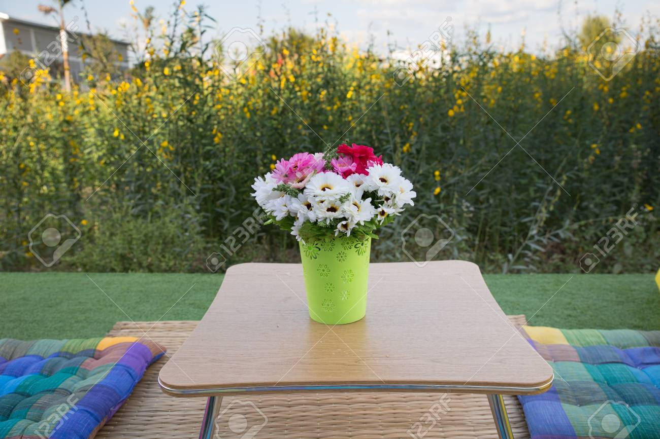 Patio Outdoor Deck With Colorful Cushion And Flower Decoration