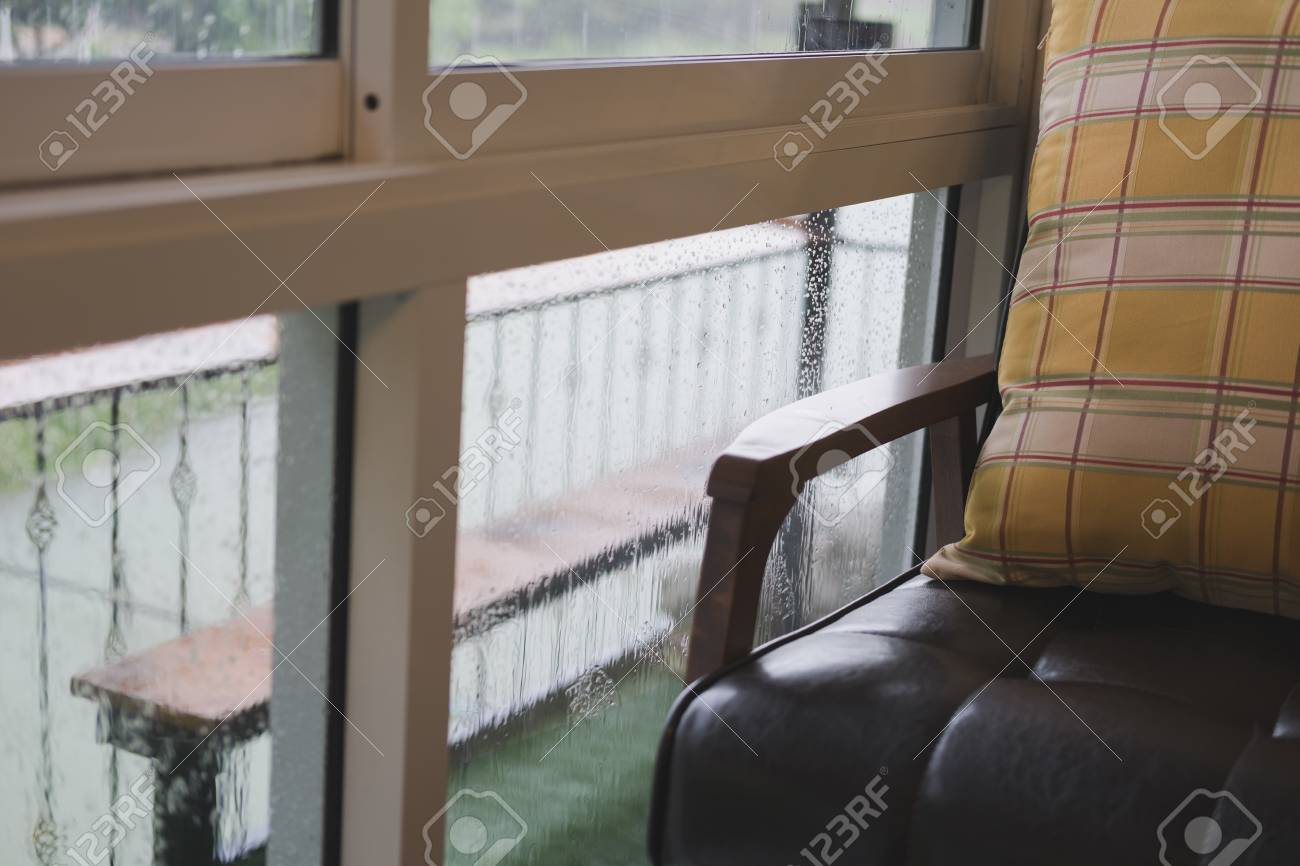 Brown Leather Chair Or Sofa Near Window With Garden View At