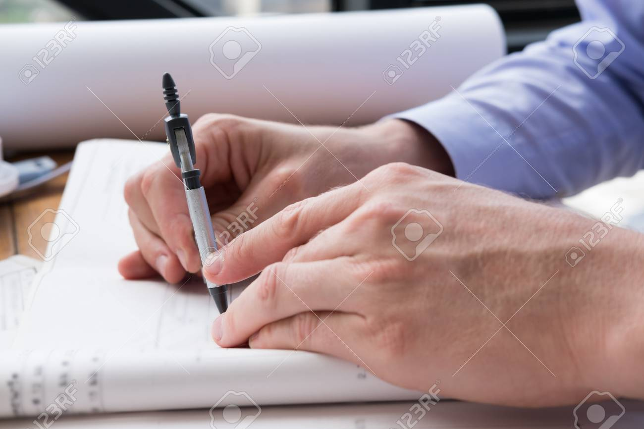Architect hand holding drawing compass working on construction architect hand holding drawing compass working on construction plan at office engineer inspect blueprint with malvernweather Image collections