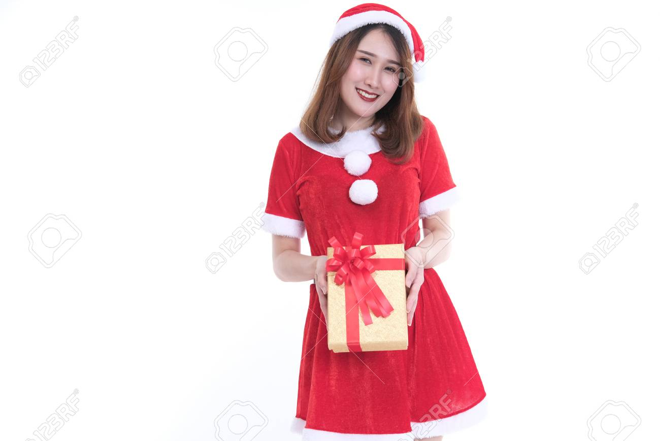 ff2c30e6d8468 portrait of asian woman in santa claus dress on white background. girl with  gift present