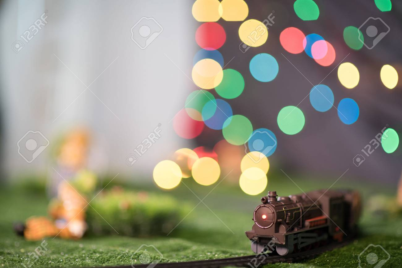 model train on railway with colorful bokeh  Locomotive on track