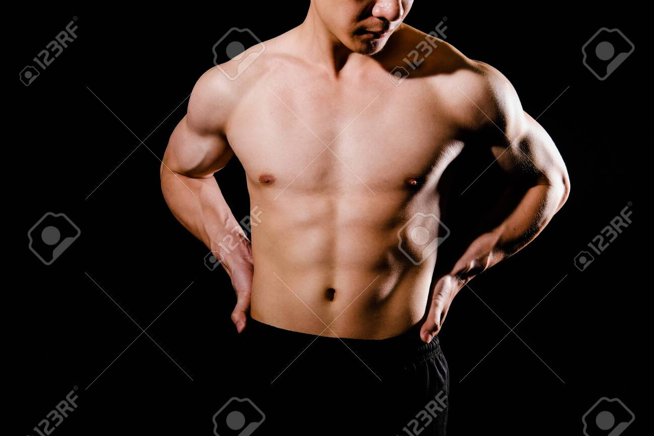 portrait of athletic muscular bodybuilder man with torso six pack abs. fitness workout concept - 130647611