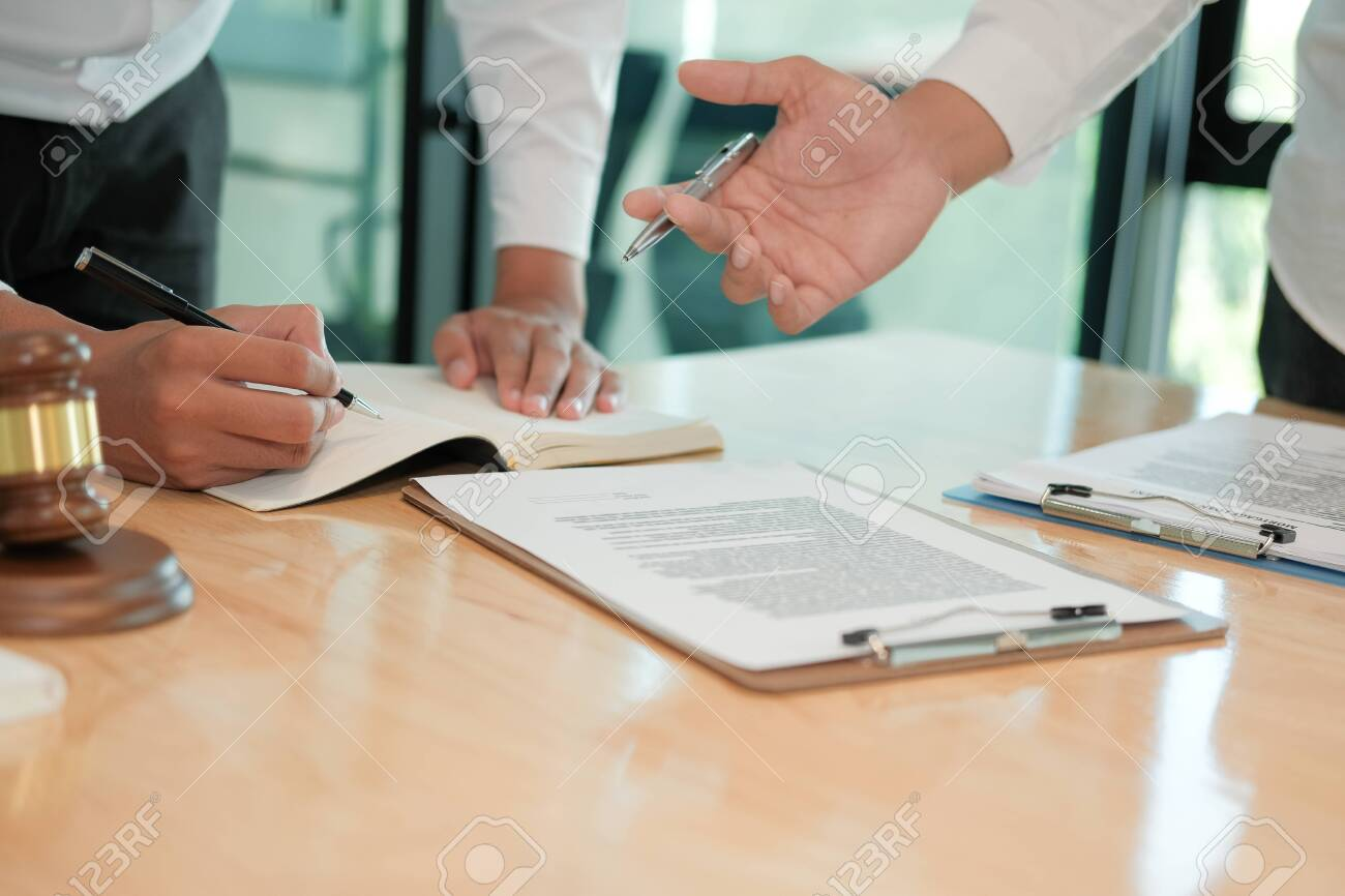 lawyer giving advice to a man. businessman discussing legal legislation at law firm. judge team meeting at courtroom - 133094698