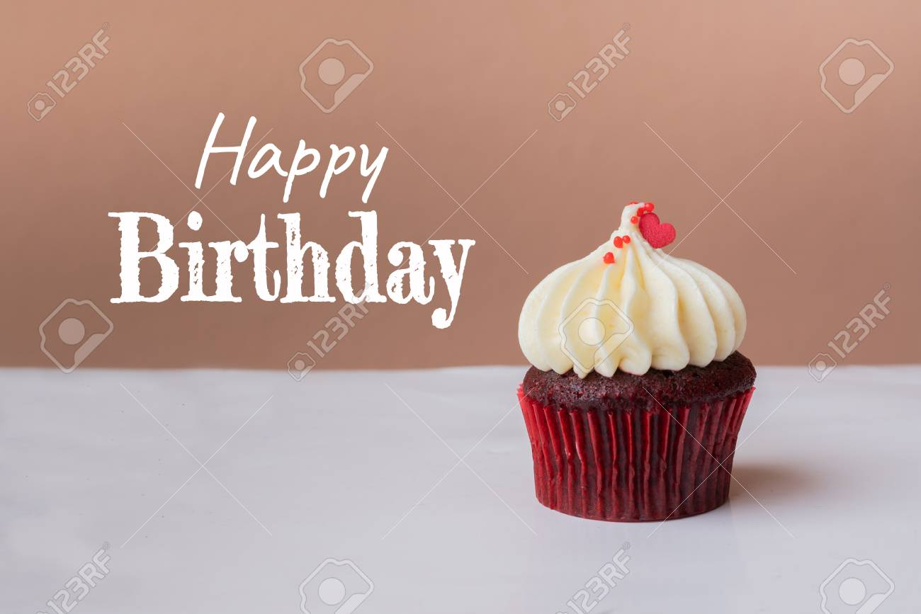 Happy Birthday Cute Cupcake With Small Red Heart On Pink Background
