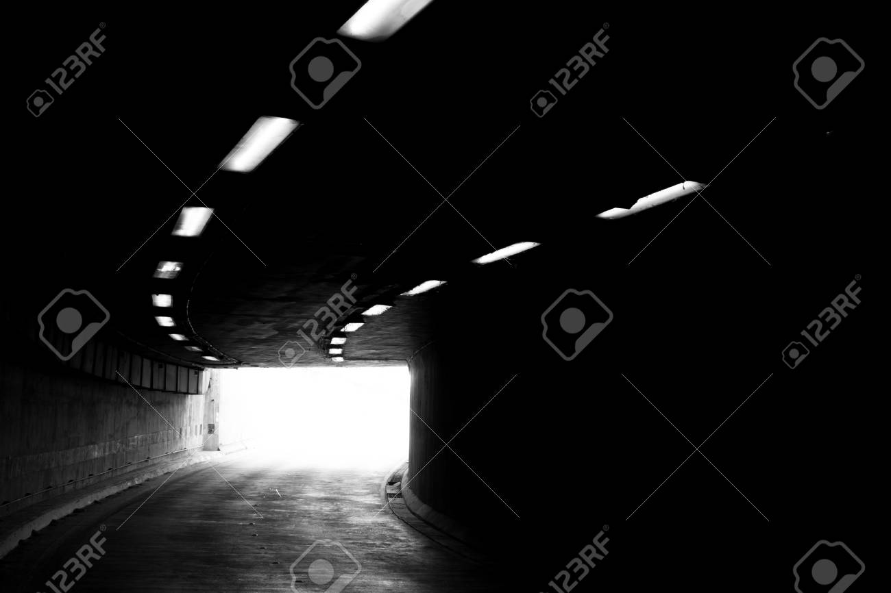 Stock photo the light at the end of the tunnel black and white photo with grain added