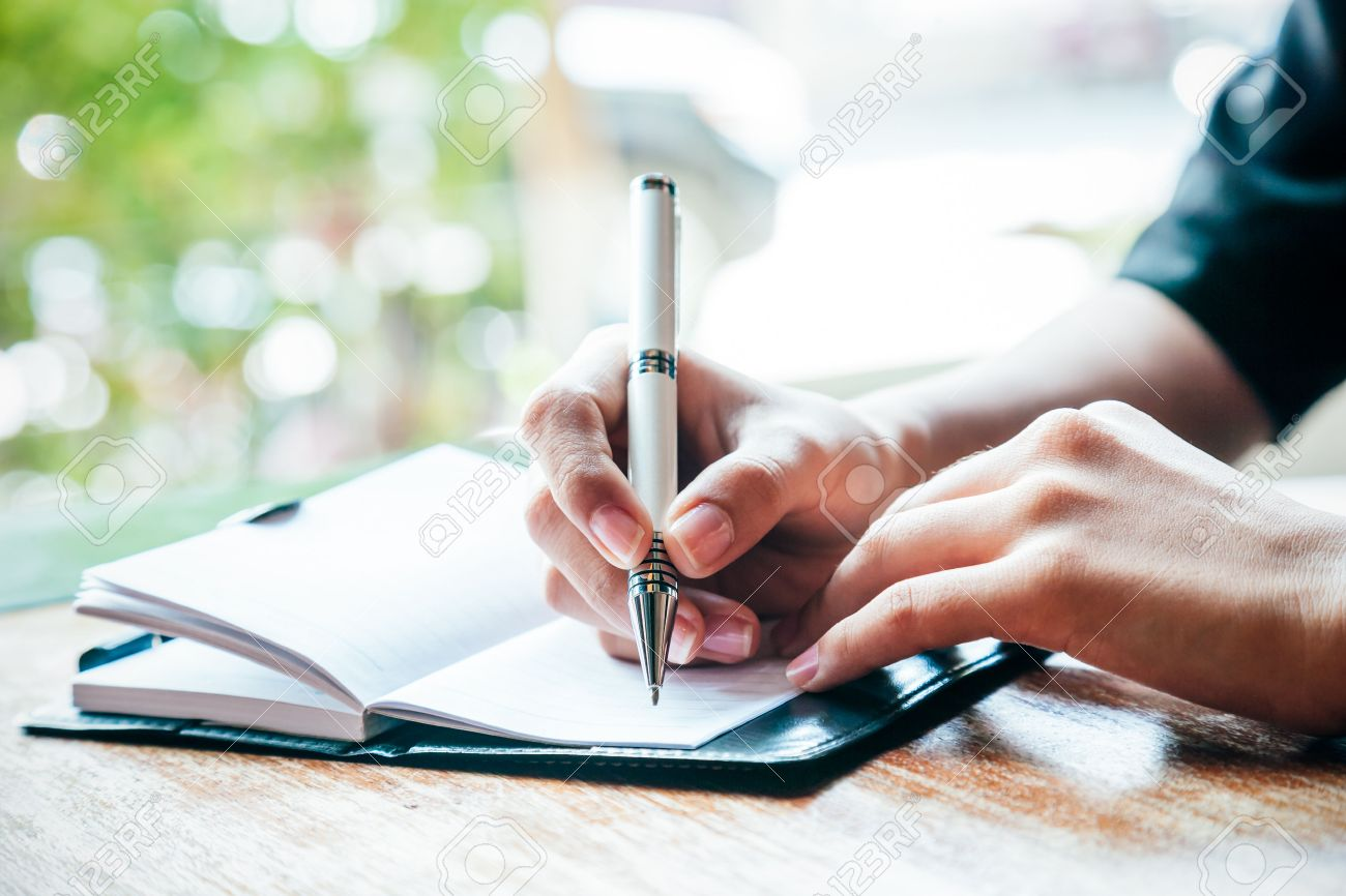 close up of woman writing her journal stock photo, picture and