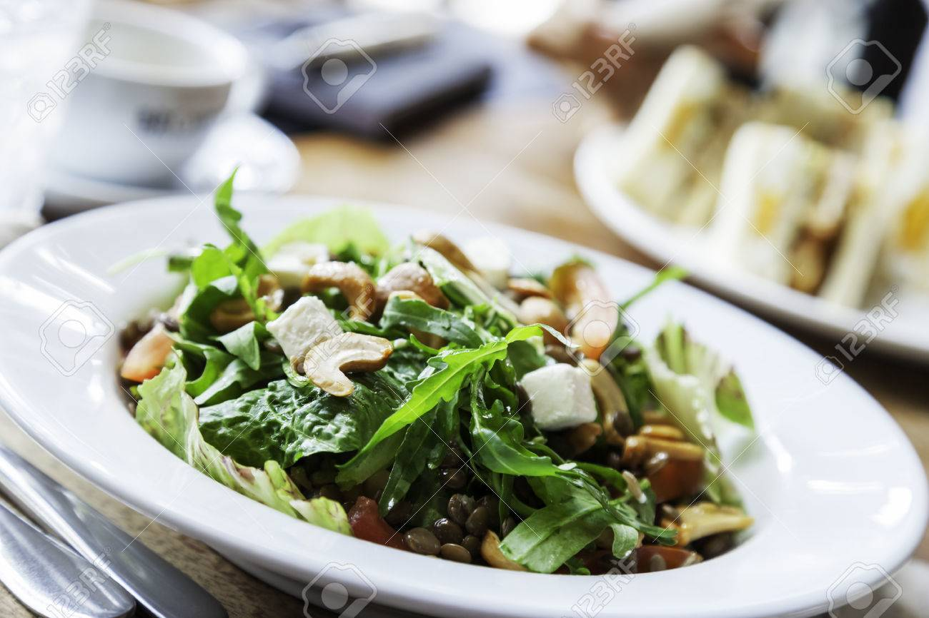 close up of salad of vegetables and cashew nuts in plate food. - 43281164