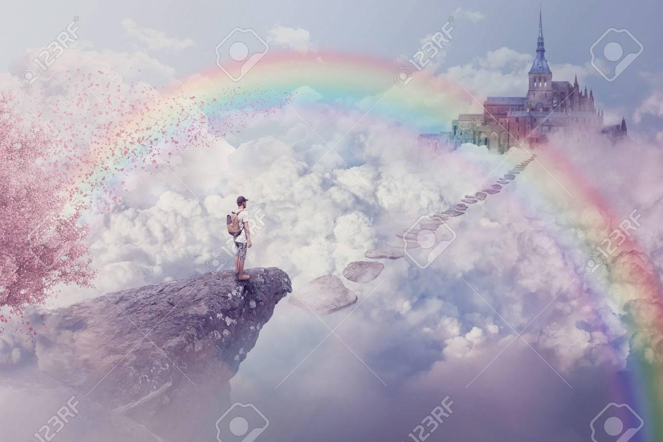 Un Chateau Dans Les Nuages monde imaginaire de vue imaginaire. jeune garçon regardant le chemin d'un  château au-dessus des nuages. voyage de vie en dessous d'un arc en ciel  dans