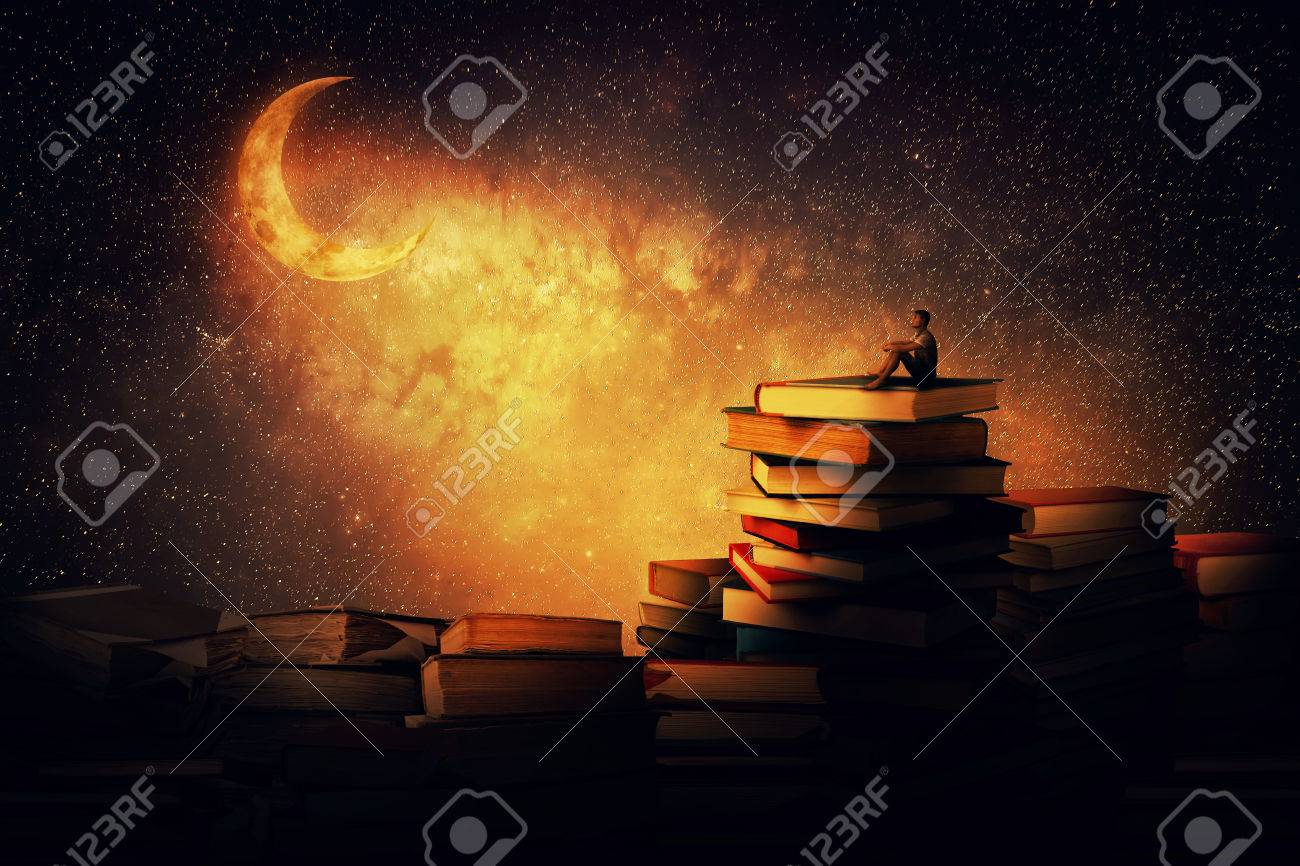 Boy sitting alone on a pile of books looking a the new moon magic