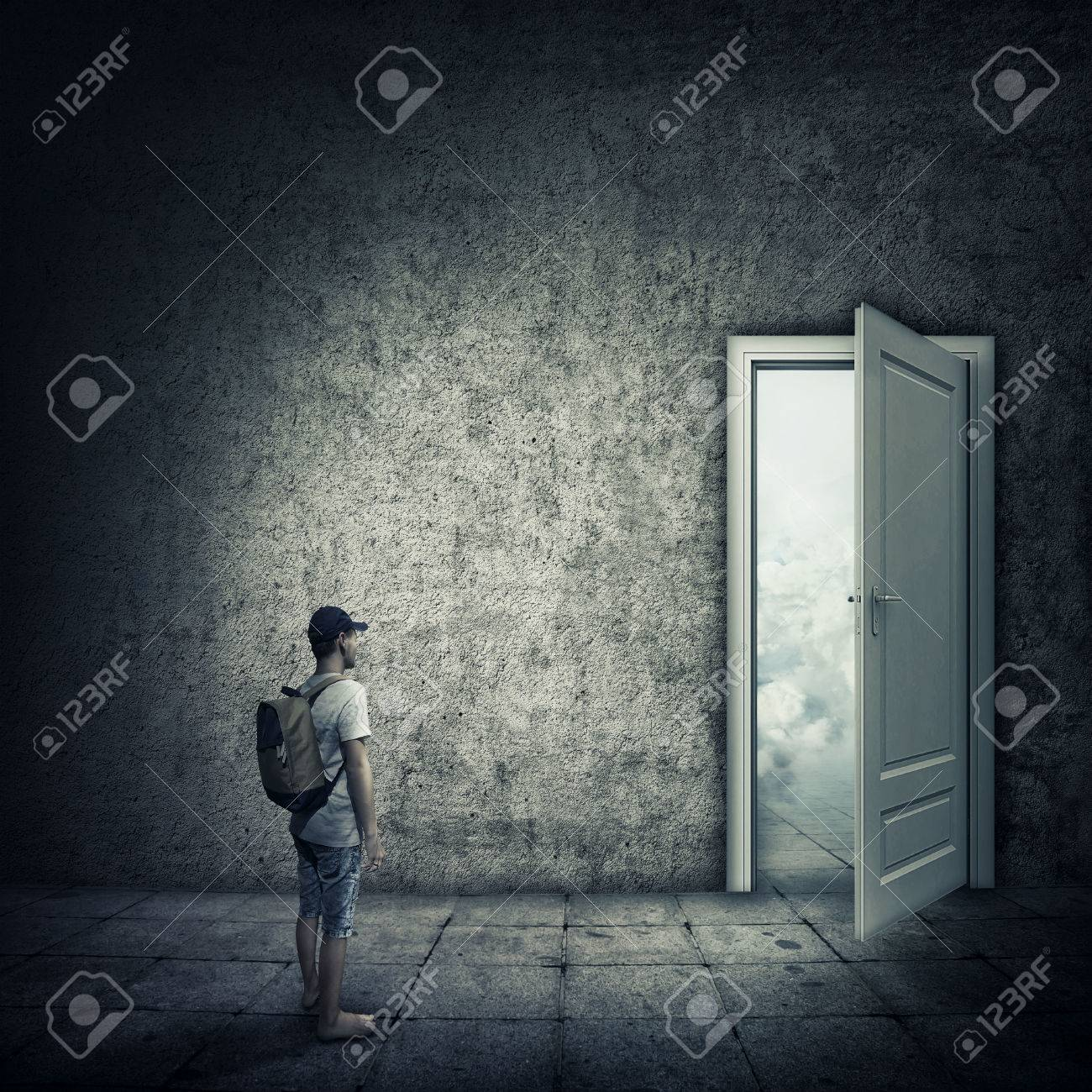 Abstract idea with a person standing in a dark room in front of a opened : door escape - pezcame.com