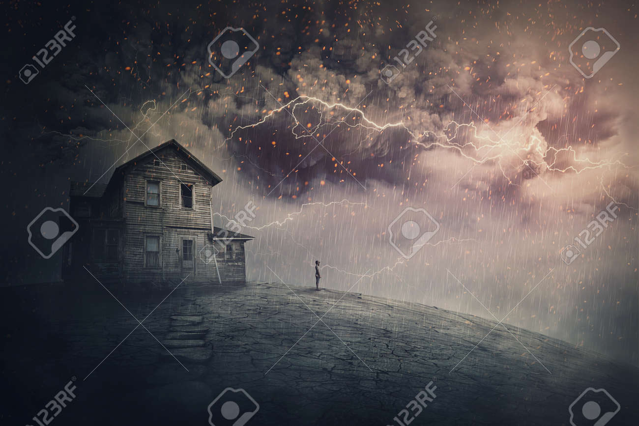 Creepy storm scene with scary lightnings over a ghost land with a haunted house and a person phantom standing under rain. Desolated mansion facing a hurricane. Spooky seasonal Halloween landscape - 168567730