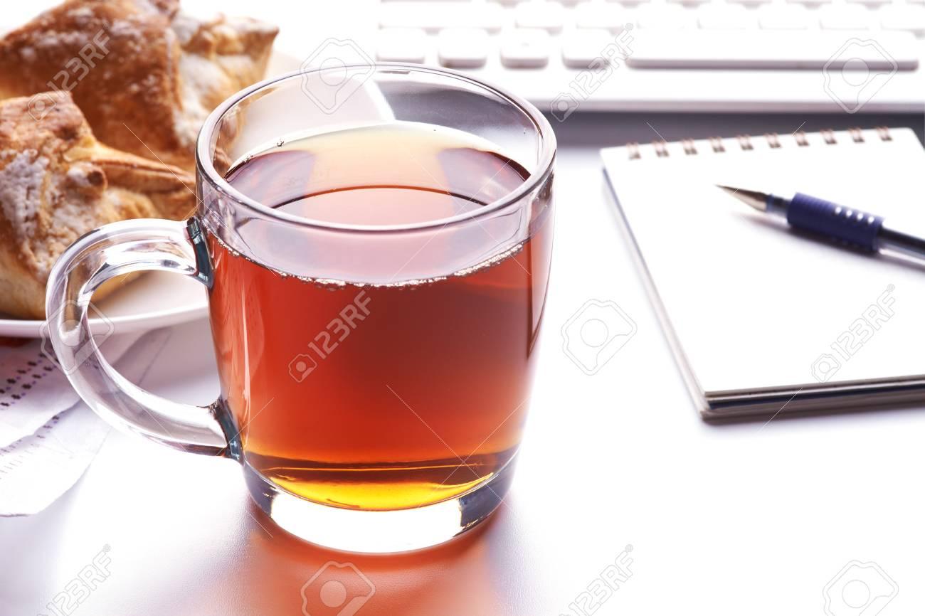 Cup of tea near keyboard on workplace Stock Photo - 16258333