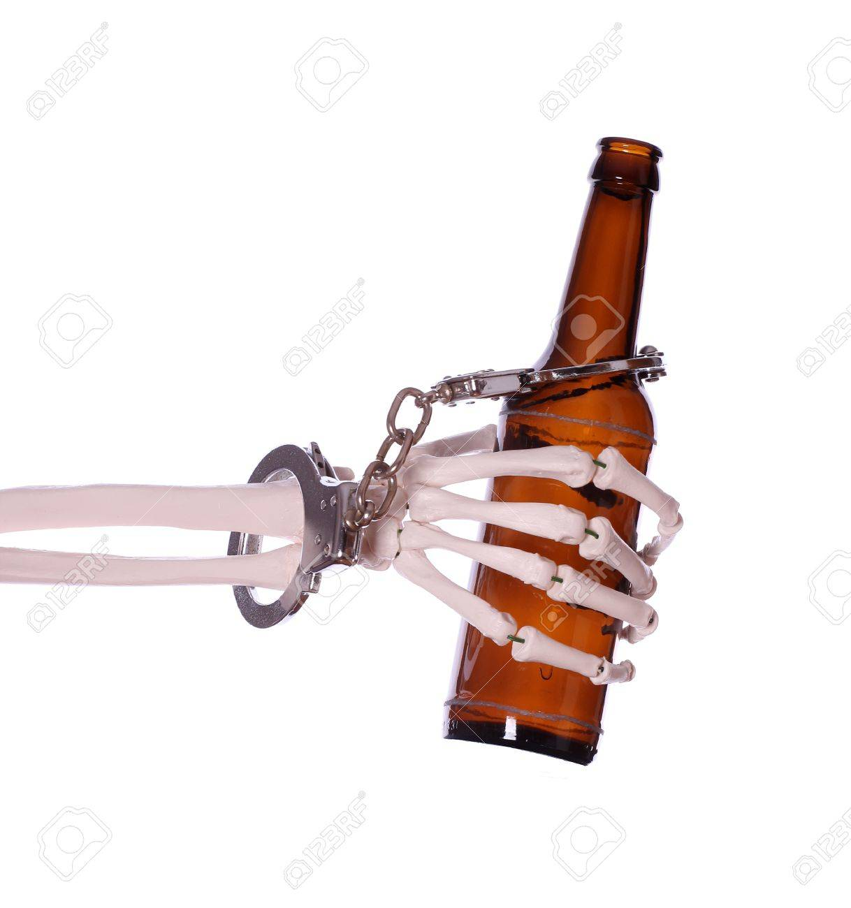 alcoholism to death with handcuff and bottle Stock Photo - 18534315