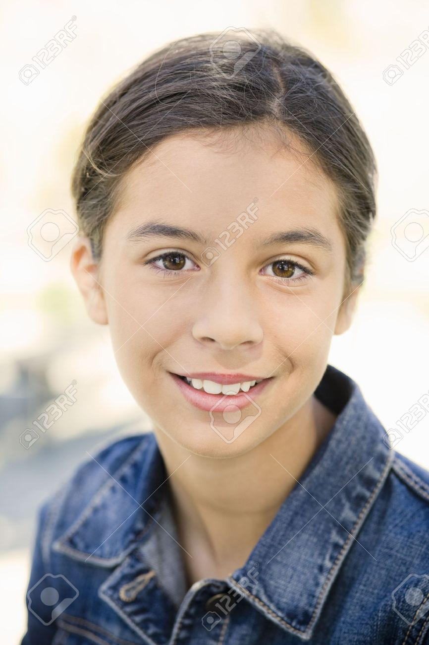 Portrait of Smiling Teenage Girl in Denim Jacket Stock Photo - 5674766