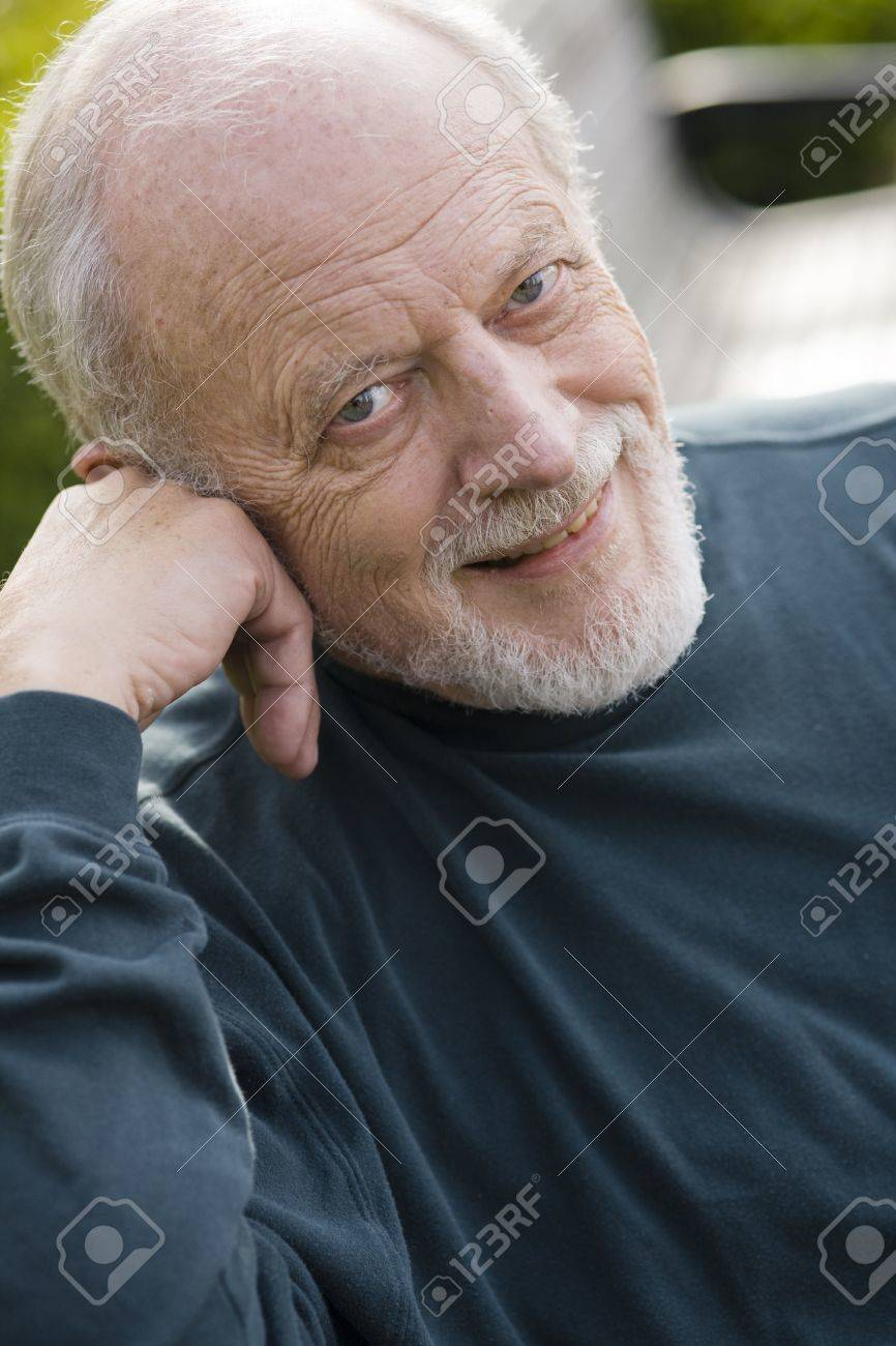 Portrait of an Elderly Gentleman Sitting on a Bench in a Park Stock Photo - 6263379