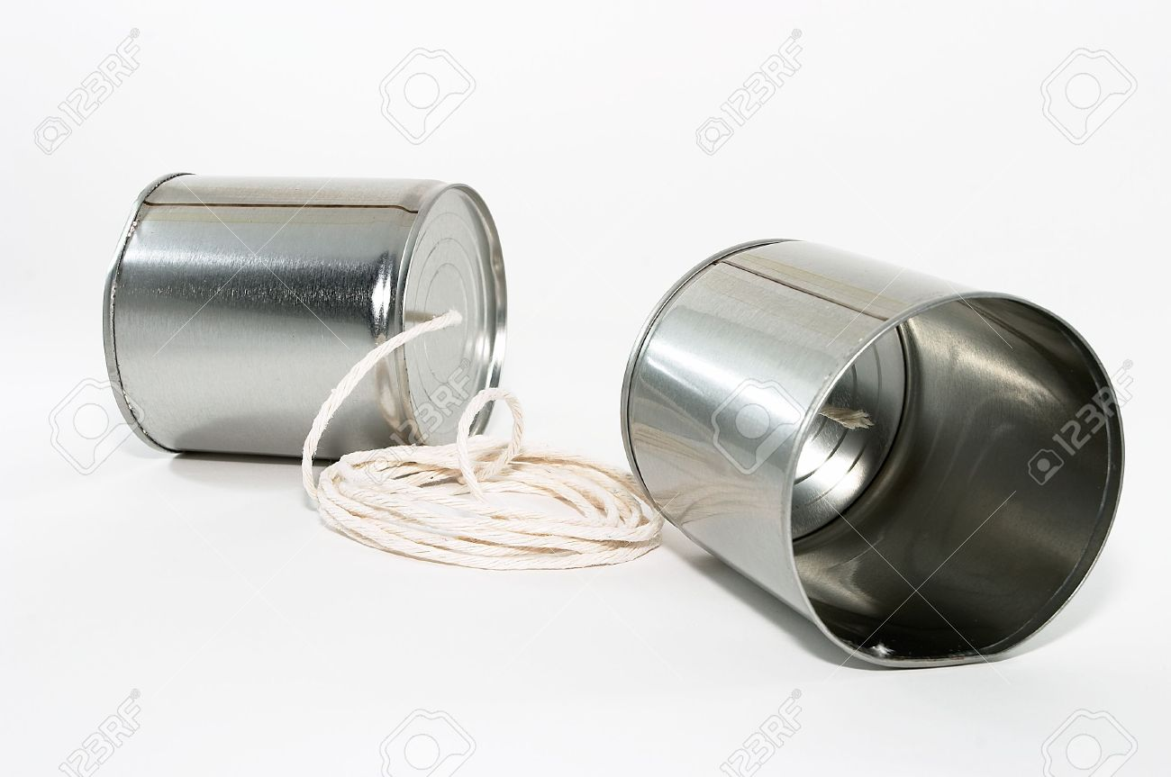 Telephones made out of tin cans and a string, emphasis on one side's tin can Stock Photo - 479307