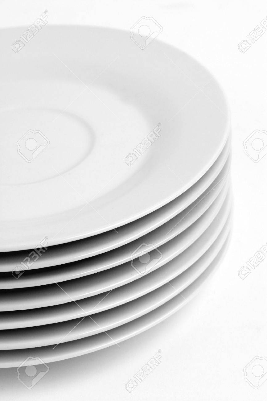 A stack of kitchen dishes, dessert plates on plain background. Stock Photo - 20382068