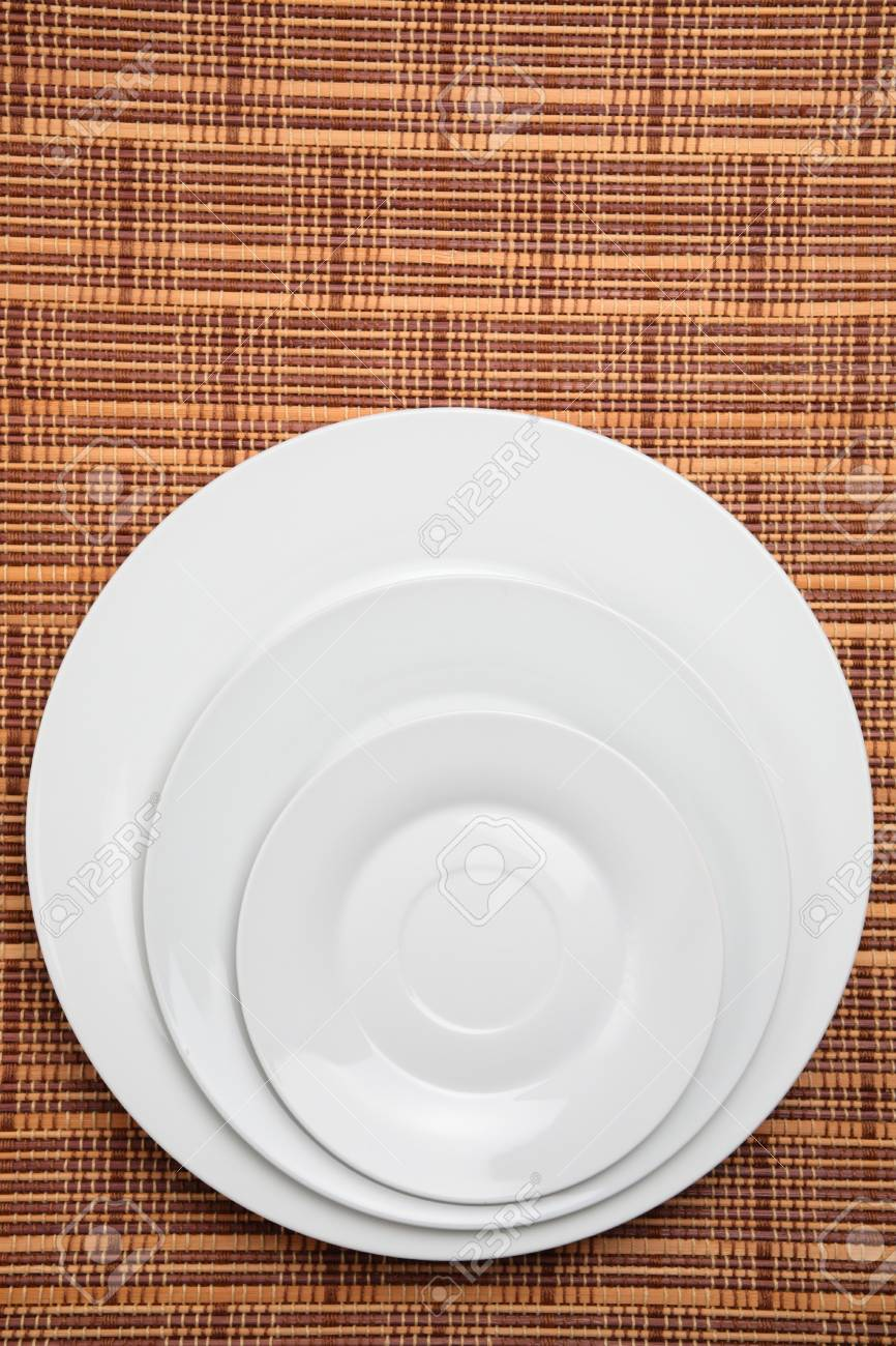 Stock Photo - Three white plates or dishes photographed over a wooden placement background. & Three White Plates Or Dishes Photographed Over A Wooden Placement ...