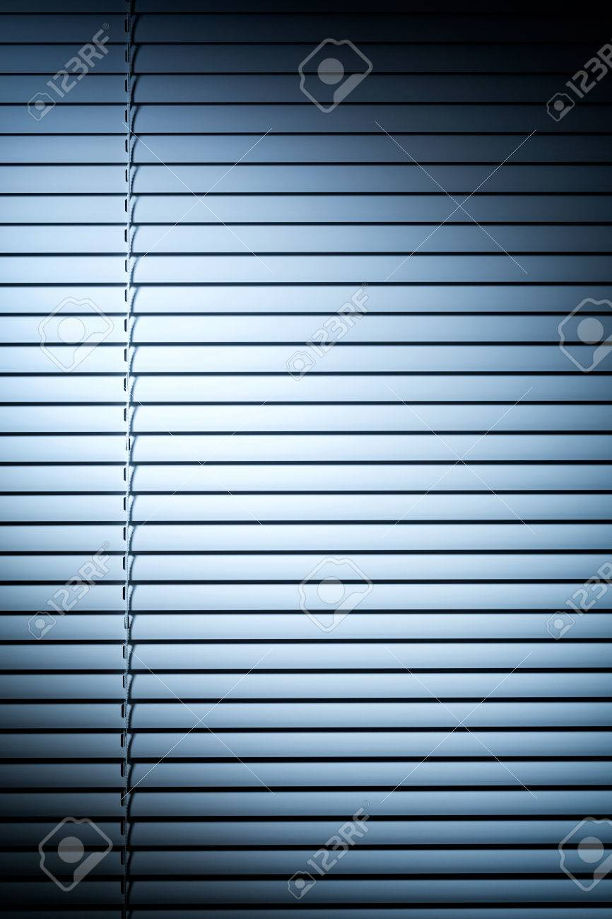 Vertical Photo Of Closed Venetian Blinds Or Shutters Under Blue