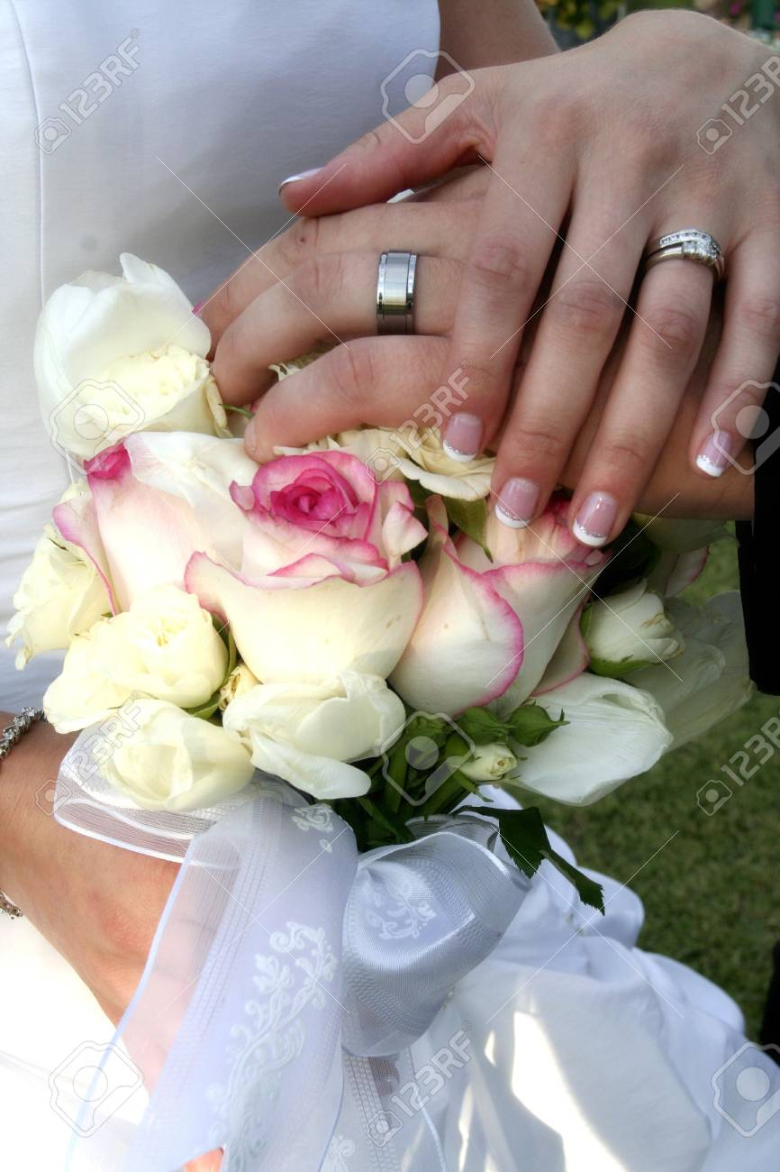 bride and groom show off their rings - 636551