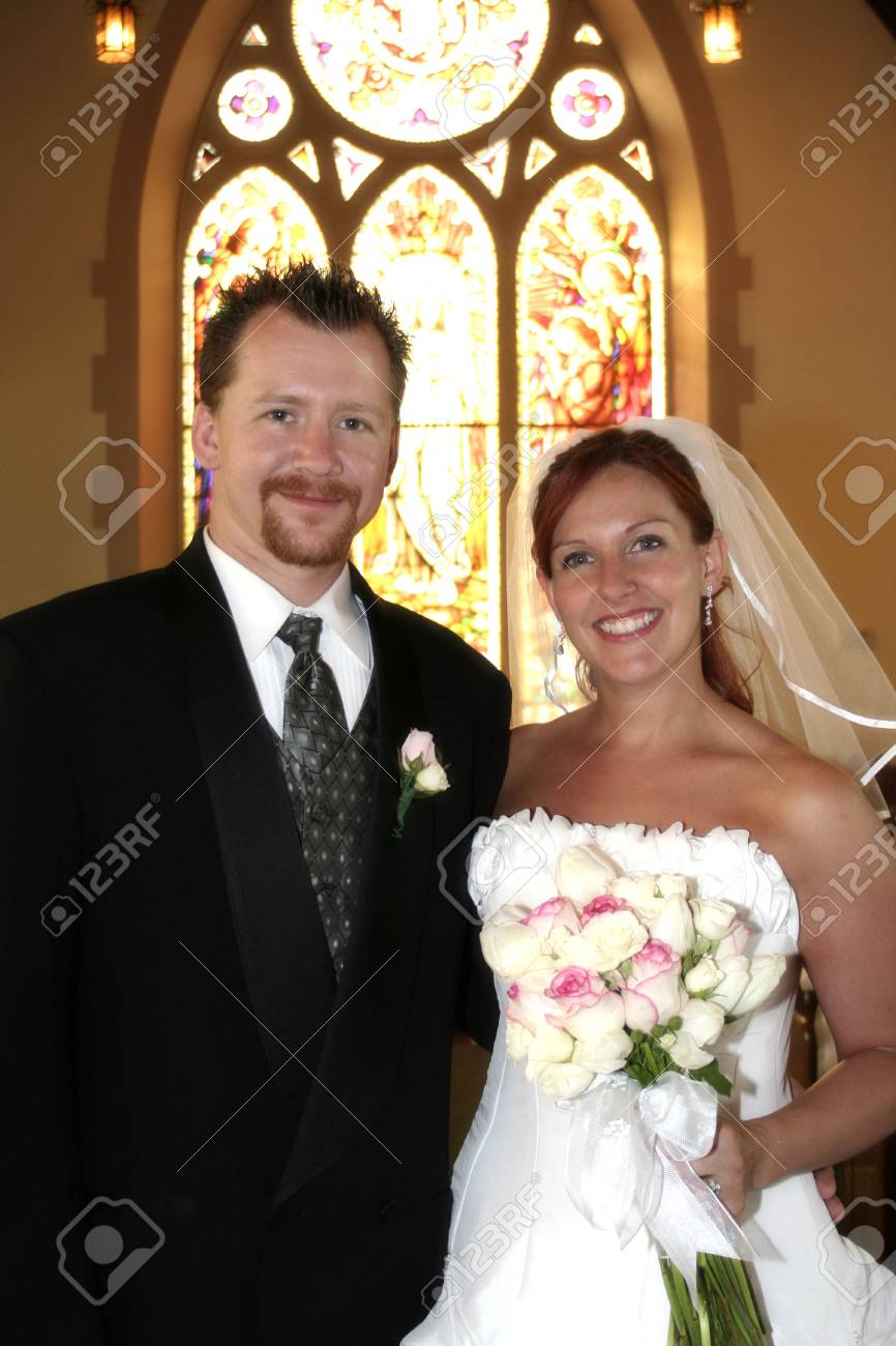 bride and groom pose for photo - 1686742