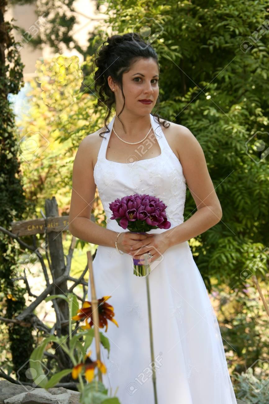 bride stands in a garden - 1686812