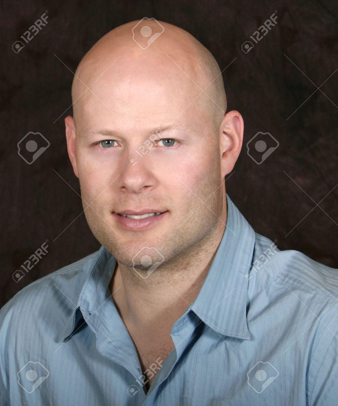 head shot of a young goodlooking bald man - 1686769