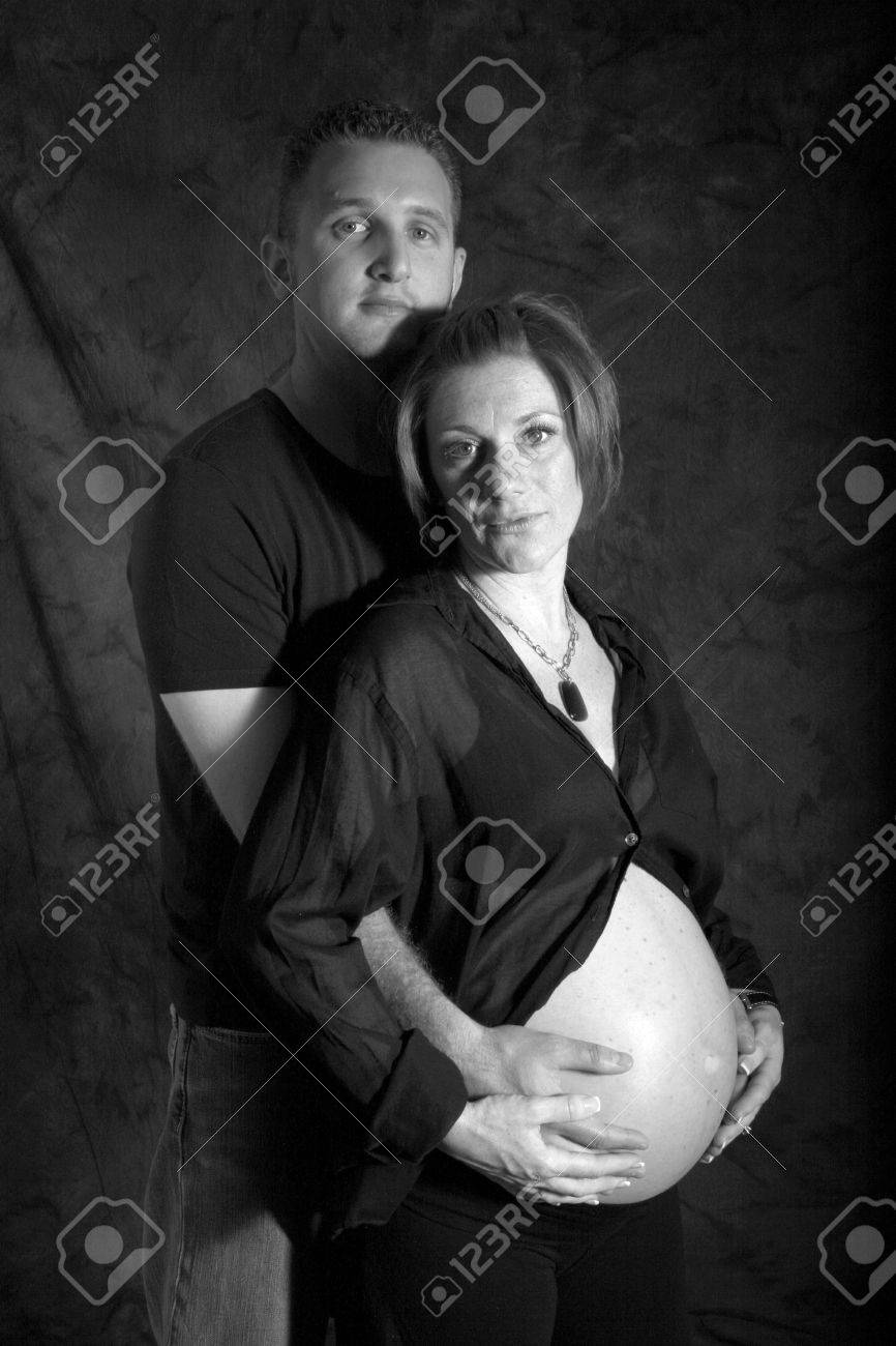 dad holds moms pregnant belly - 1686801