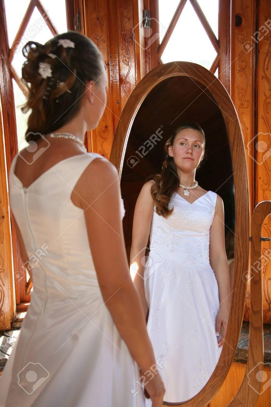 bride looks into a mirror - 1686809