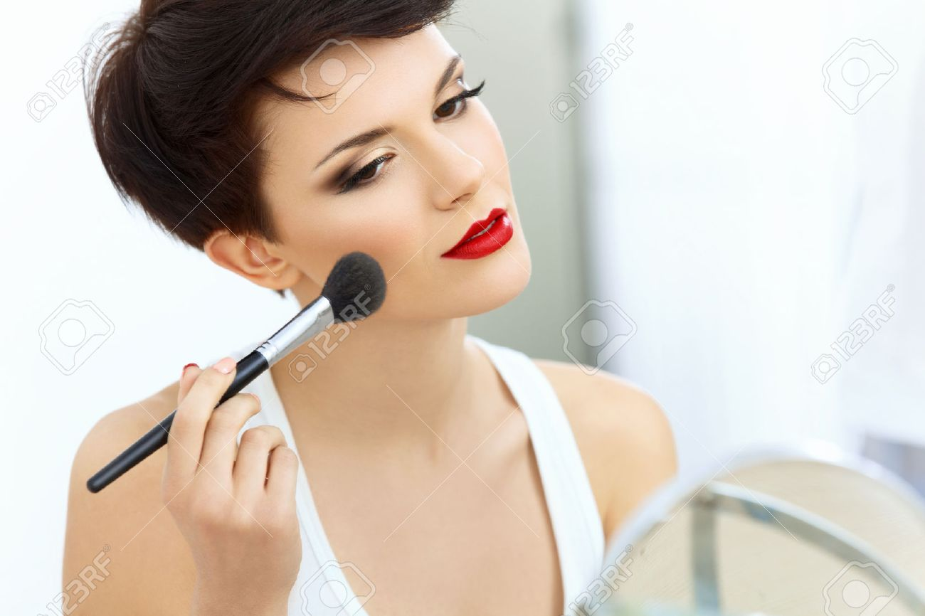 Beauty Girl with Makeup Brush. Natural Make-up for Brunette Woman with Red Lips. Beautiful Face. Applying Makeup - 39805672
