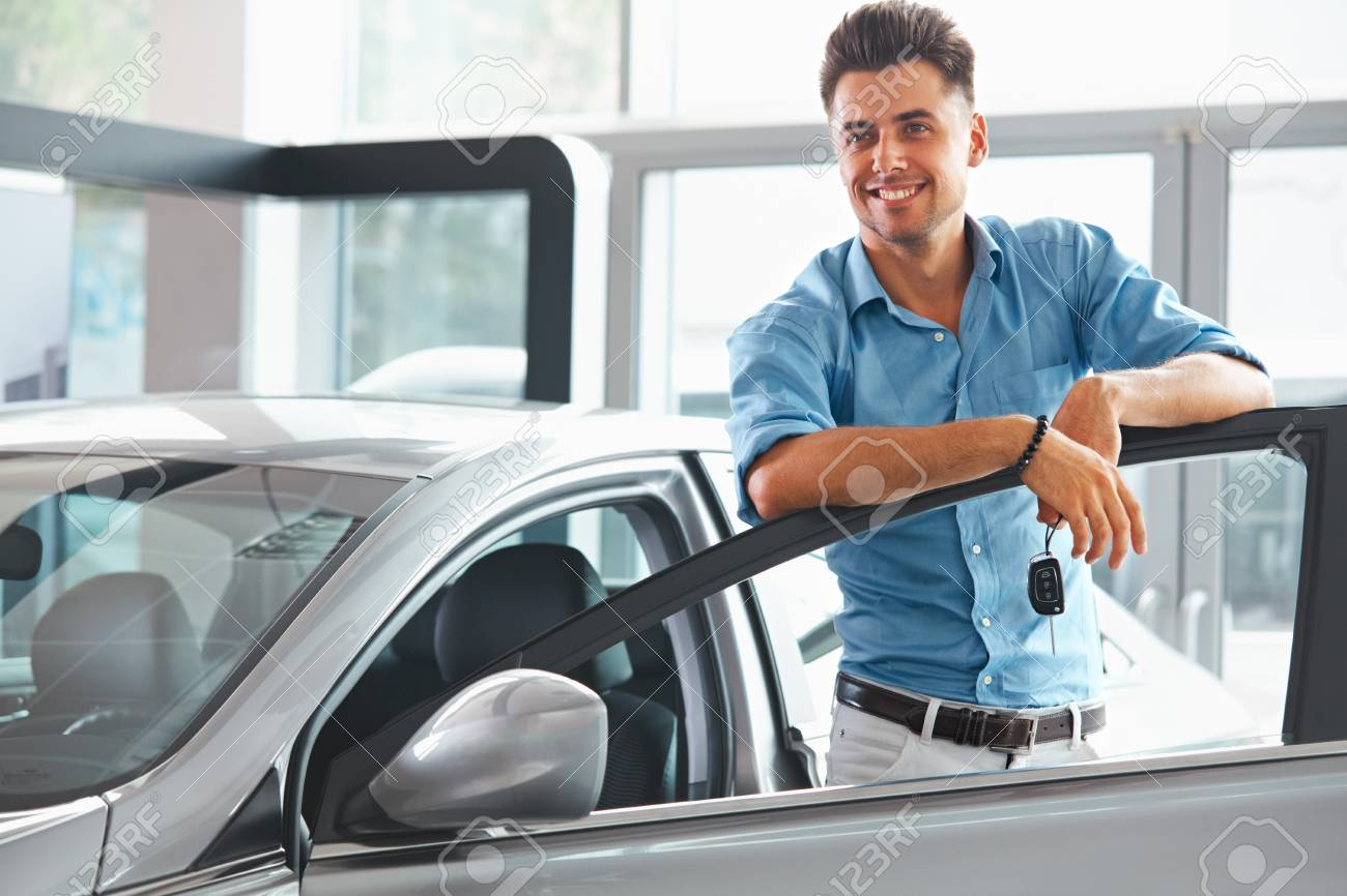 Car Showroom Happy Man With Keys To The Car Of His Dreams Stock Photo Picture And Royalty Free Image Image 45680381