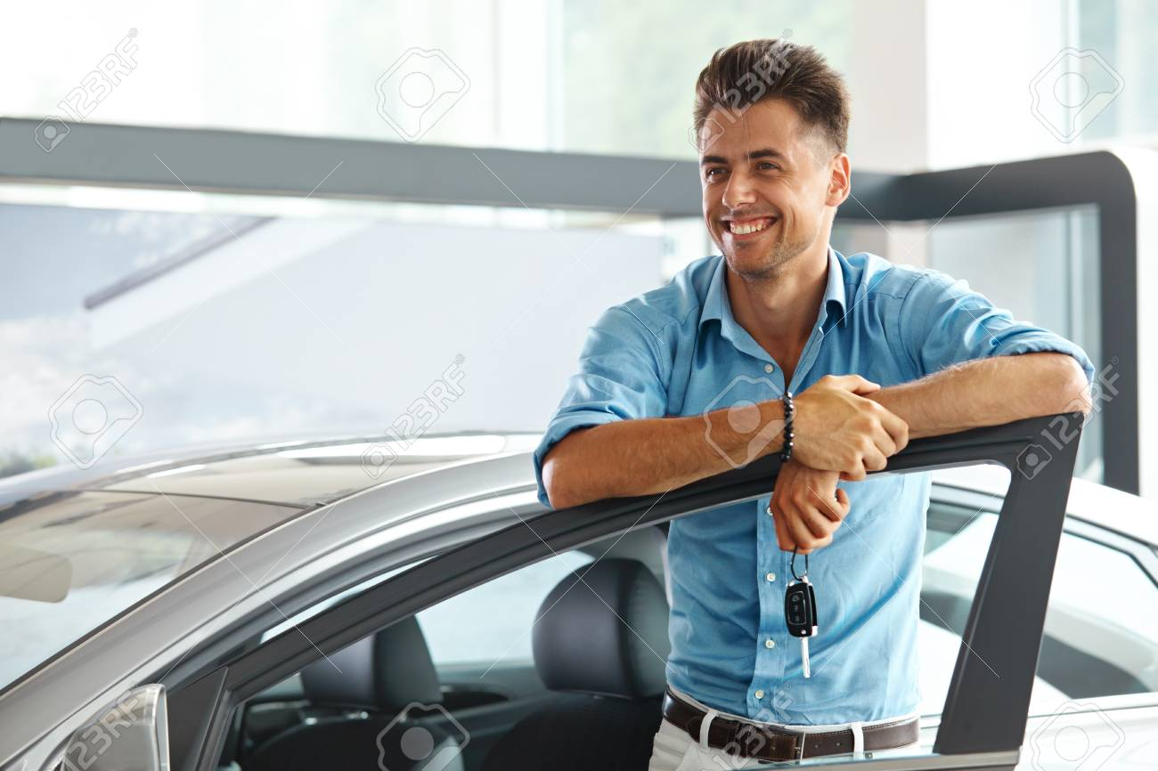 Car Showroom Happy Man With Keys To The Car Of His Dreams Stock Photo Picture And Royalty Free Image Image 68402249