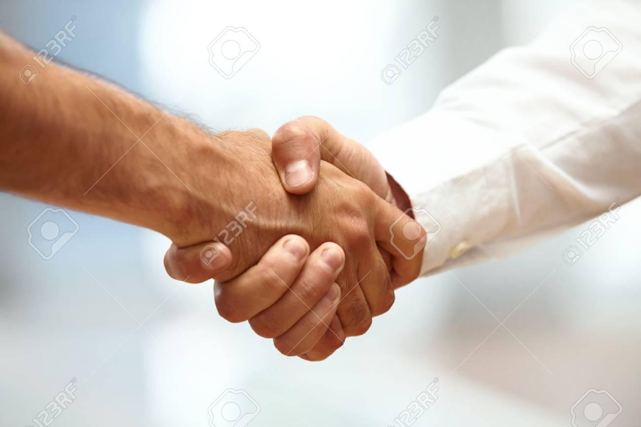 Closeup of a business handshake - 38694307