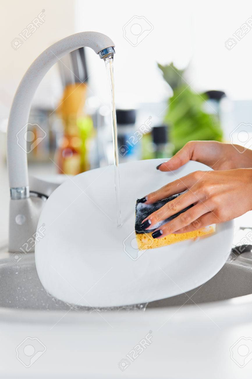 Close Up Manicured Hands Of Young Woman Washing White Dishes.. Stock ...