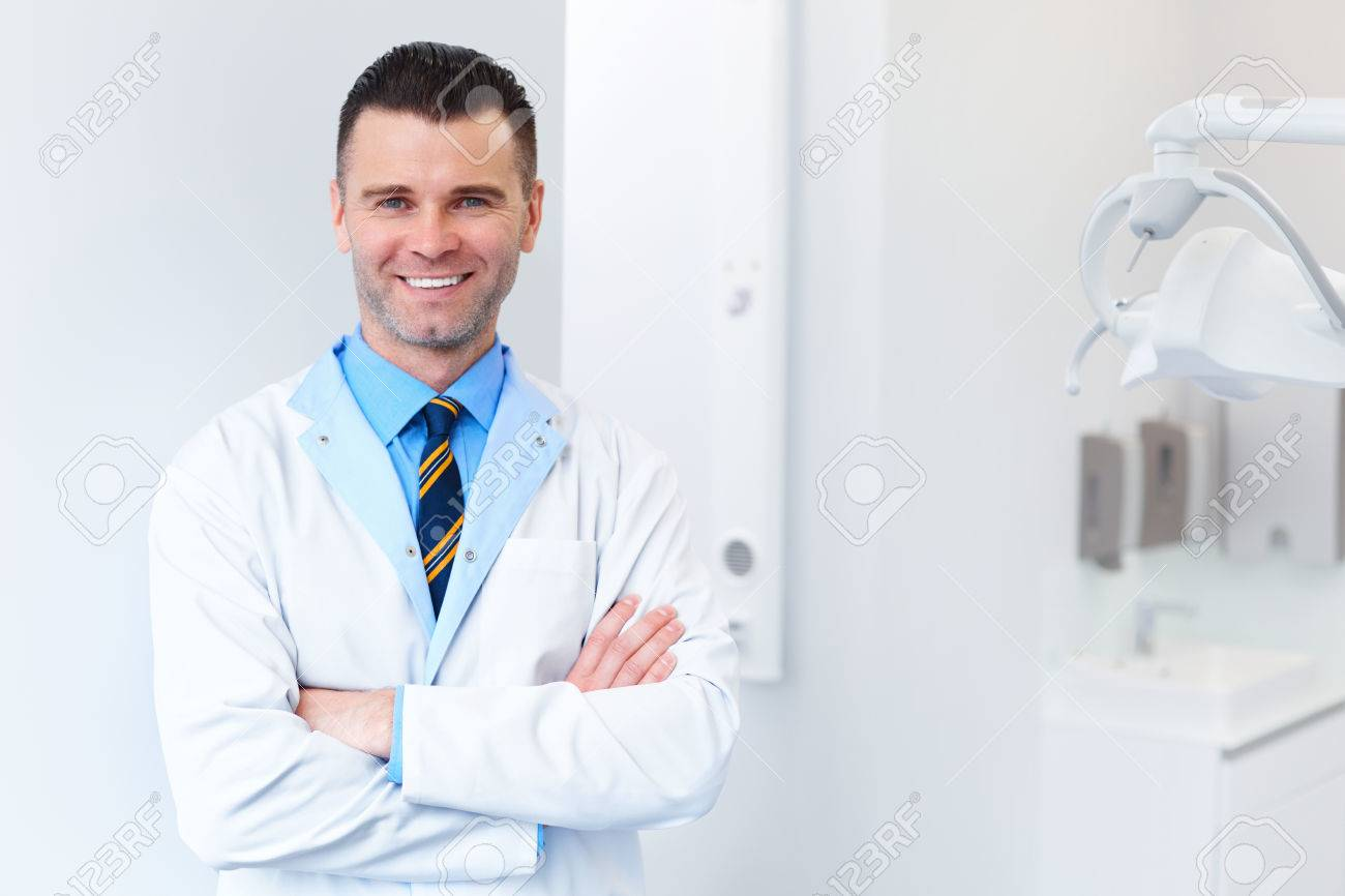 Dentist Doctor Portrait  Young Man at His Workplace  Dental Clinic