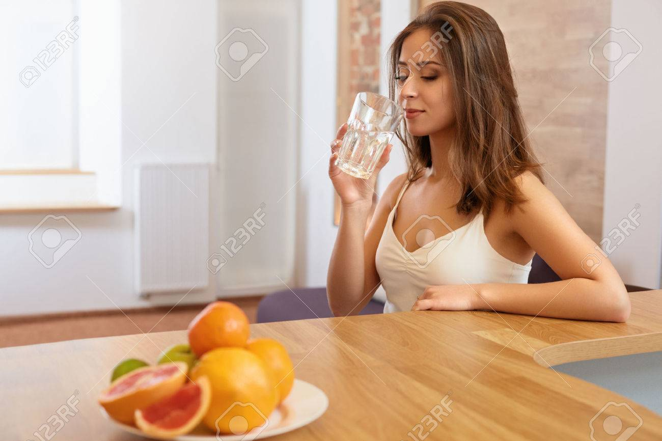 Young Woman with glass of Water. Healthy Lifestyle Stock Photo - 45859285