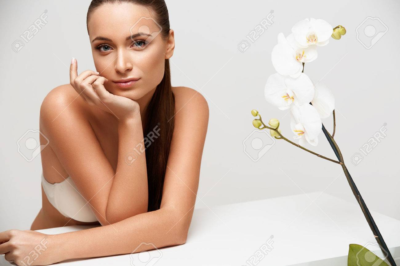 Spa Woman. Beautiful Girl Touching Her Face. Perfect Skin. Skincare. Wellness advertising - 45940717