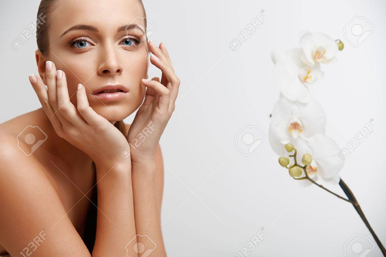 Spa Woman. Beautiful Girl Touching Her Face. Perfect Skin. Skincare. Wellness advertising - 45941071
