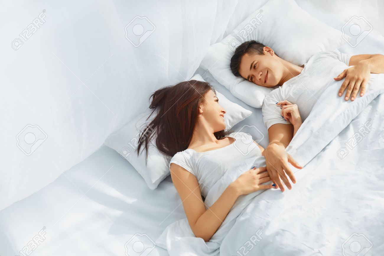 Lovely Couple In Bed Lying In Bedroom Young Love Couple Lying In The Bed Romantic Scene In Bedroom