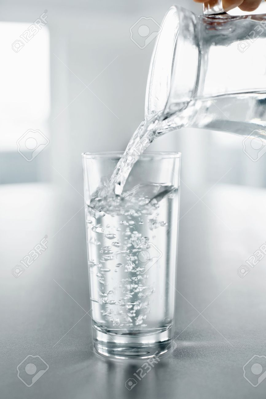 drink water pouring fresh crystal clear drinking water from stock