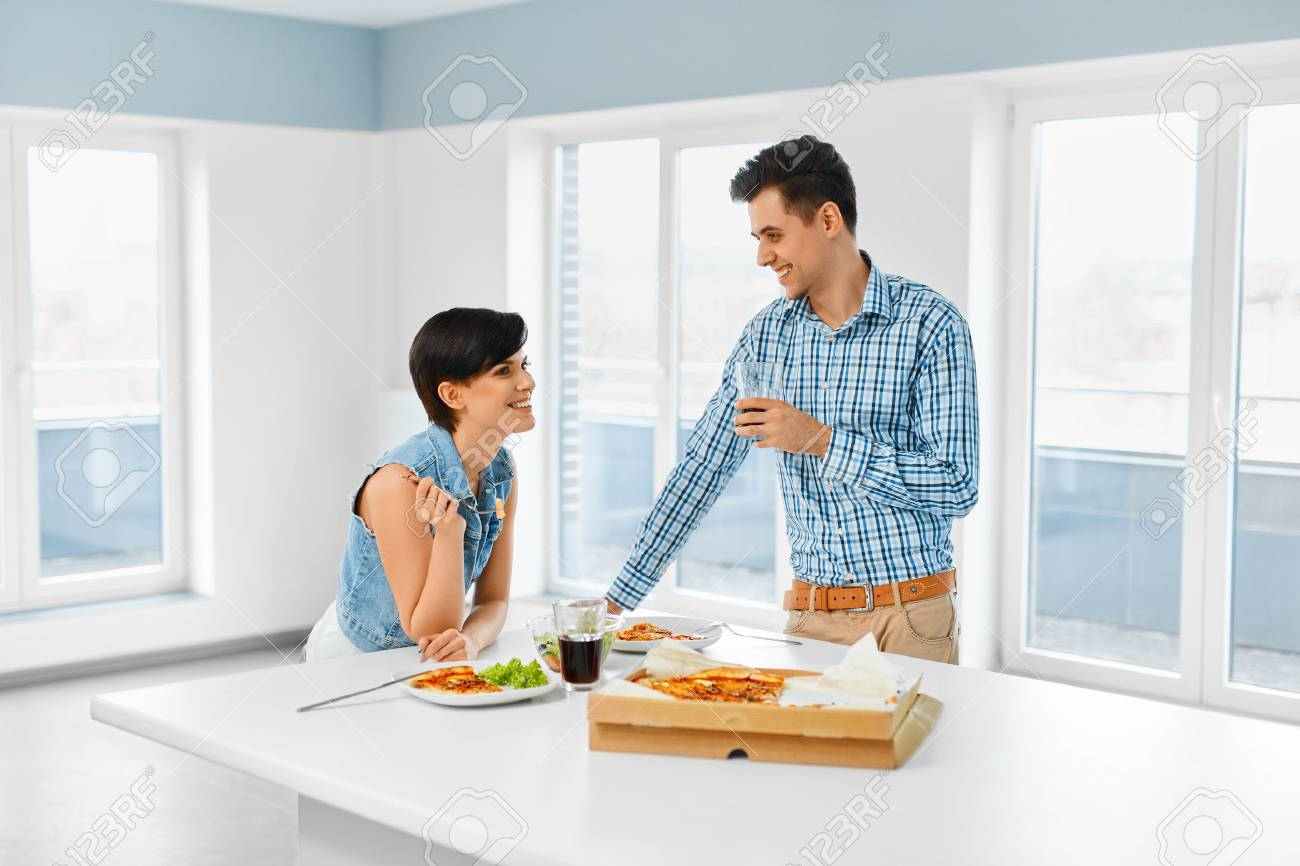 Eating Food. Happy Lovely Couple Eating Pizza, Drinking Soda.. Stock ...