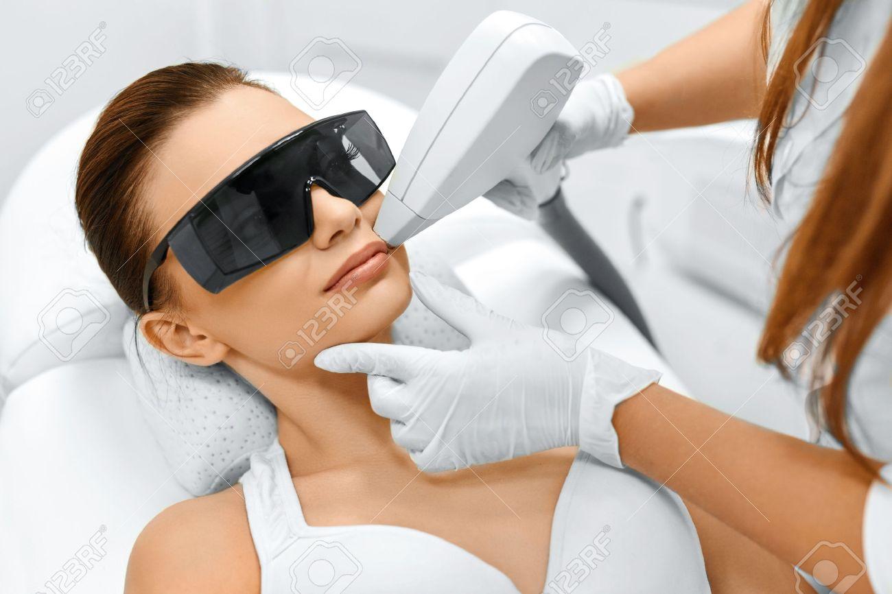 Face Care Facial Laser Hair Removal Beautician Giving Laser - Laser hair removal face